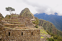 THE INKA RUINS AT MACHUA PICCHU IN PERU