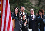Gov. Brian Sandoval, center, and his wife Kathleen, far right, listen as daughters Maddy, 18, and Marisa, 10, lead the crowd in the Pledge of Allegiance at the inauguration at the Capitol, in Carson City, Nev., on Monday, Jan. 5, 2015. <br /> Photo by Cathleen Allison