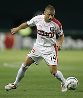 9 April 2005.   Chicago Fire midfielder Chris Armas (14) dribbles the ball upfield at RFK Stadium in Washington, DC.