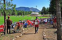 Jul 31, 2009; Flagstaff, AZ, USA; Fans look on as Arizona Cardinals players practice during training camp on the campus of Northern Arizona University. Mandatory Credit: Mark J. Rebilas-