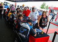 Jun 9, 2017; Englishtown , NJ, USA; NHRA top fuel drivers Shawn Langdon (right) and Troy Coughlin Jr sign autographs during qualifying for the Summernationals at Old Bridge Township Raceway Park. Mandatory Credit: Mark J. Rebilas-USA TODAY Sports