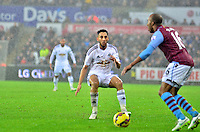 Pictured: Friday 26 December 2014<br /> Re: Premier League, Swansea City FC v Aston Villa at the Liberty Stadium, Swansea, south Wales, UK.<br /> <br /> Swansea's Neil Taylor defending against Fabian Delph