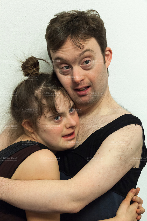 """Switzerland. Canton Ticino. Gordola. Casa Riposo (Retirement Home) Solarium. MOPS_DanceSyndrome is an independent Swiss artistic, cultural and social organisation operating in the field of contemporary dance and disability. It is composed only of Down dancers. Simone Lunardi (R) holds Gaia Mereu (L) in his arms at the end of """"Choreus Numinis"""" show. Down syndrome (DS or DNS), also known as trisomy 21, is a genetic disorder caused by the presence of all or part of a third copy of chromosome 21 It is usually associated with physical growth delays, mild to moderate intellectual disability, and characteristic facial features. A group of elderly people, all seated in wheelchairs, look at the woman dancing. A retirement home – sometimes called an old people's home or old age home - is a multi-residence housing facility intended for the elderly. Gordola is a municipality in the district of Locarno. 29.11.2019 © 2019 Didier Ruef"""