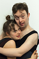 "Switzerland. Canton Ticino. Gordola. Casa Riposo (Retirement Home) Solarium. MOPS_DanceSyndrome is an independent Swiss artistic, cultural and social organisation operating in the field of contemporary dance and disability. It is composed only of Down dancers. Simone Lunardi (R) holds Gaia Mereu (L) in his arms at the end of ""Choreus Numinis"" show. Down syndrome (DS or DNS), also known as trisomy 21, is a genetic disorder caused by the presence of all or part of a third copy of chromosome 21 It is usually associated with physical growth delays, mild to moderate intellectual disability, and characteristic facial features. A group of elderly people, all seated in wheelchairs, look at the woman dancing. A retirement home – sometimes called an old people's home or old age home - is a multi-residence housing facility intended for the elderly. Gordola is a municipality in the district of Locarno. 29.11.2019 © 2019 Didier Ruef"