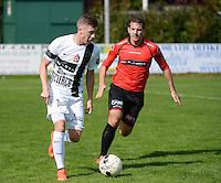 Winkel Sport - SK Deinze  : Tibo Van De Velde (links) aan de bal voor David Cardon (r) <br /> foto VDB / BART VANDENBROUCKE