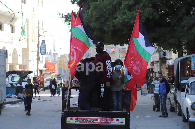 """Palestinian supporters of the Popular Front for the Liberation of Palestine, and National Initiative party, take part in a protest against postponement of the Palestinian parliamentary and presidential elections and support of the Al-Aqsa Mosque, at al-shate' camp in Gaza city, on May 1, 2021. Palestinian President Mahmoud Abbas """"indefinitely postponed"""" three separate rounds of elections in the occupied Palestinian territories that had been scheduled to start on 22 May. His announcement, four months ago, of dates for these elections had come as a pleasant surprise to many Palestinians. Photo by Mahmoud Ajjour"""