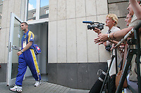Ukraine national team forward Andriy Shevchenko exits from the Hilton Hotel in downtown Cologne, Germany as a crowd of onlookers watch from behind a barricade.  The Ukraine national team members were boarding a bus to the Cologne World Cup stadium for their soccer team's second round FIFA World Cup match in Cologne, Germany on Monday, June 26th 2006 against Switzerland. Ukraine defeated Switzerland by penalty kicks 3-0.