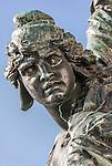 Bronze statue of Venice in chains at the base of the Victor Emmanuel statue, Riva degli Schiavoni, Venice, Italy.