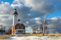 Winter setting in at the historic Au Sable Light Station along Pictured Rocks National Lakeshore. Grand Marais, MI