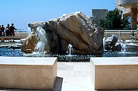 Richard Meier: The Getty Center Boulder Fountain in Museum Courtyard. Spraying water is welcome on this hot terrace.  Photo '99.