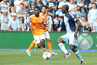 Lawrence Olum (13) defender Sporting KC in action..Sporting Kansas City and Houston Dynamo played to a 1-1 tie at Sporting Park, Kansas City, Kansas.