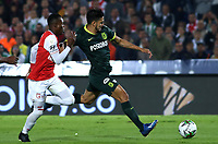 BOGOTA-COLOMBIA, 08-03-2020: Carlos Arboleda de Independiente Santa Fe y Andres Andrade de Atletico Nacional disputan el balon durante partido de la fecha 8 entre Independiente Santa Fe y Atletico Nacional, por la Liga BetPLay DIMAYOR I 2020, en el estadio Nemesio Camacho El Campin de la ciudad de Bogota. / Carlos Arboleda of Independiente Santa Fe and Andres Andrade of Atletico Nacional vie for the ball during a match of the 8th date between Independiente Santa Fe and Atletico Nacional, for the BetPlay DIMAYOR I Leguaje 2020 at the Nemesio Camacho El Campin Stadium in Bogota city. / Photo: VizzorImage / Daniel Grazon / Cont.