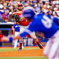 26 March 2018: St. Louis Cardinals pitcher Brett Cecil makes a pickoff attempt in the 6th inning of an exhibition game against the Toronto Blue Jays at Olympic Stadium in Montreal, Quebec, Canada. The Cardinals defeated the Blue Jays 5-3 in the first of two MLB pre-season games in the former home of the Montreal Expos. Mandatory Credit: Ed Wolfstein Photo *** RAW (NEF) Image File Available ***