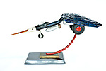 Title: Peace Bird<br /> Materials: Flat Shovel, Shovel Handle, Brass, Black Granite, Model Airplane and Tires<br /> Size: 15Tx32x10<br /> Price: Available on Request