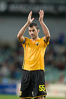 SYDNEY, AUSTRALIA - JULY 31, 2010: Traianos Dellas of AEK Athens thanks the crowd after the match between AEK Athens FC and Glasgow Rangers at the 2010 Sydney Festival of Football held at the Sydney Football Stadium on July 31, 2010 in Sydney, Australia. (Photo by Sydney Low / www.syd-low.com)