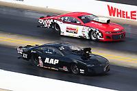 Oct 12, 2019; Concord, NC, USA; NHRA pro mod driver Mike Castellana (near) alongside Rickie Smith during qualifying for the Carolina Nationals at zMax Dragway. Mandatory Credit: Mark J. Rebilas-USA TODAY Sports