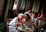 Two women eat breakfast and talk in the casino of Pamplona after the fifth San Fermin Festival bull run, on July 11, 2012, in Pamplona, northern Spain. The festival is a symbol of Spanish culture that attracts thousands of tourists to watch the bull runs despite heavy condemnation from animal rights groups. (c) Pedro ARMESTRE