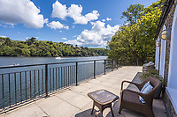 BNPS.co.uk (01202 558833)<br /> Pic: March&Petit/BNPS<br /> <br /> Pictured: The view of the River Dart.<br /> <br /> The ultimate riverside lifestyle is up for grabs with this waterfront home on the market for £3m.<br /> <br /> Rosebank is in an unrivalled spot on the banks of the River Dart, close to a historic church and castle, with spectacular views over the water.<br /> <br /> The three-bedroom property in Dartmouth, Devon, has its own boathouse and direct access to the river, as well as a superb riverside terrace.<br /> <br /> The house is close to the mouth of the river, with St Petrox Church and Dartmouth Castle as its neighbours, which are just visible from the veranda.