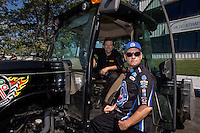 Jun. 2, 2013; Englishtown, NJ, USA: NHRA funny car driver Del Worsham sits in a tractor as he talks with Robert Hight during the Summer Nationals at Raceway Park. Mandatory Credit: Mark J. Rebilas-
