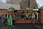 Norwich City 1 Manchester United 0, 17/11/2012. Carrow Road, Premier League. A woman selling programmes outside Carrow Road stadium, home of Norwich City before the team took on Manchester United in a Barclays Premier League fixture. The home team won the match by one goal to nil watched by a crowd of 26,840. It was Norwich City's first victory against Manchester United since 2005. Photo by Colin McPherson.