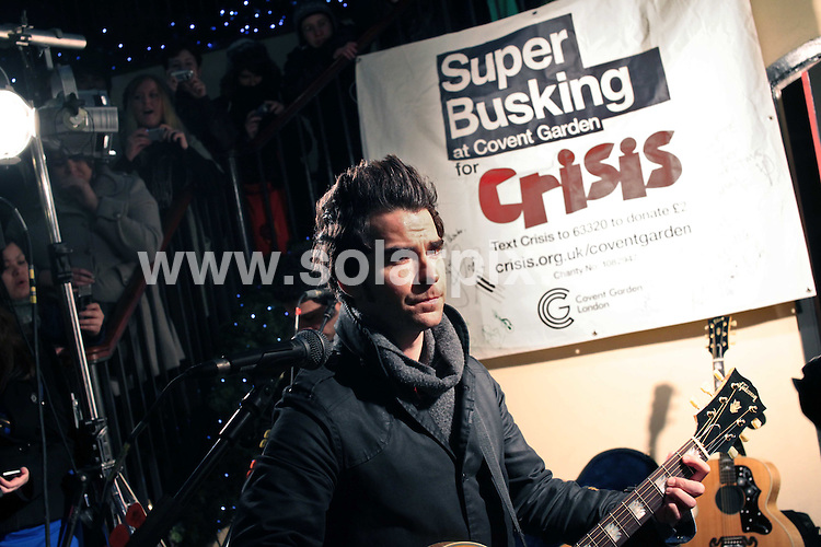 **ALL ROUND PICTURES FROM SOLARPIX.COM**.**NO UK NEWSPAPER PUBLICATION**.**UK MAGAZINE & SUPPLEMENT PUBLICATION ONLY** AND NO PUBLICATION IN AUSTRALIA, BELGIUM, FRANCE, GERMANY, ITALY, SCANDINAVIA AND USA** .The Stereophonics  surprised shoppers in Covent Garden this evening with a 'Super Busking' gig as part of Covent Garden's free 'Very Merry Christmas' programme...The Super Busks will see famous music artists turn up at Covent Garden  Market building for impromtu live busking sessions throughout the Christmas period. London, UK. 13 December 2009..This pic: Kelly Jones from the Stereophonics..JOB REF: 10390 SFE       DATE: 13_12_2009.**MUST CREDIT SOLARPIX.COM OR DOUBLE FEE WILL BE CHARGED**.**MUST NOTIFY SOLARPIX OF ONLINE USAGE**.**CALL US ON: +34 952 811 768 or LOW RATE FROM UK 0844 617 7637**