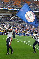 Virginia wide receiver Joe Reed waves the Virginia State Flag as he comes onto the field. The Virginia Cavaliers defeated the Pitt Panthers 30-14 in a football game at Heinz Field, Pittsburgh, Pennsylvania on August 31, 2019.