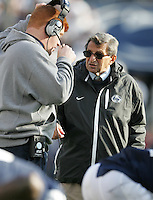 State College, PA - 11/06/2010:  Joe Paterno speaks with WR coach Mike McQueary during the first half.  Despite trailing 21-0 in the first quarter, Penn State defeated Northwestern by a score of 35-21 at Beaver Stadium to give head coach Joe Paterno his 400th career victory...Photo:  Joe Rokita / JoeRokita.com..Photo ©2010 Joe Rokita Photography