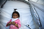 Cristel in San Jose El Recreo, San Marcos, a 7.4 earthquake struck Guatemala Wednesday Nov. 7. awaits emergency food relief. ..provided emergency shelter by ShelterBox, an international disaster relief charity. .