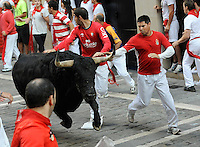 Participants run ahead of Valdefresno fighting bulls during the third San Fermin Festival´s running of the bulls, on July 9, 2013, in Pamplona, Basque Country. On each day of the eight San Fermin festival days six bulls are released at 8:00 a.m. (0600 GMT) to run from their corral through the narrow, cobbled streets of the old navarre town over an 850-meter (yard) course. Ahead of them are the runners, who try to stay close to the bulls without falling over or being gored. (Ander Gillenea / Bostok Photo)