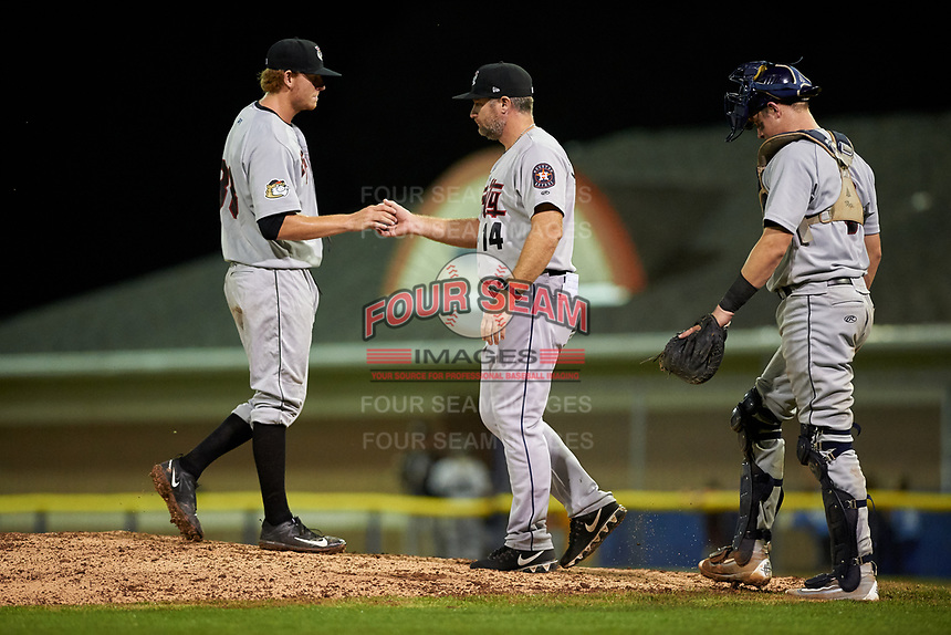 Tri-City ValleyCats pitcher Tyler Ivey (41) hands the ball to manager Morgan Ensberg (14) as catcher Michael Papierski (9) looks on during a game against the Batavia Muckdogs on July 14, 2017 at Dwyer Stadium in Batavia, New York.  Batavia defeated Tri-City 8-4.  (Mike Janes/Four Seam Images)