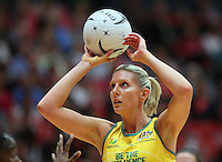 Australia's Cath Cox attempts a shot at goal against England in the New World Quad series netball match, TECT Arena, Tauranga, New Zealand, Sunday, October 28, 2012. Credit:NINZ / Dianne Manson.