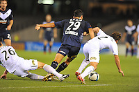 MELBOURNE, AUSTRALIA - FEBRUARY 5, 2010: Nik Mrdja from Melbourne Victory fights for the ball in round 26 of the A-league match between Melbourne Victory and North Queensland Fury at Etihad Stadium on February 5, 2010 in Melbourne, Australia. Photo Sydney Low www.syd-low.com