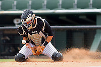 Catcher Kevin Dubler #27 of the Kannapolis Intimidators slides to block a throw to the plate against the Lexington Legends at Fieldcrest Cannon Stadium on May 11, 2011 in Kannapolis, North Carolina.   Photo by Brian Westerholt / Four Seam Images