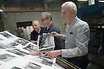 Italian book printers EBS Verona. Dewi Lewis English photography book publisher checking flat sheets for print qquality and density. 2016 2010s