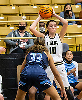 Gracie Eaves (10) of Bentonville looks for open player with Pacious Mcdaniel (33) of Spring Har-ber defending at Tiger Arena, Bentonville, AR January 5, 2021 / Special to NWA Democrat-Gazette/ David Beach