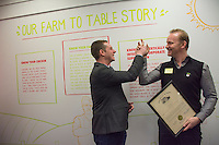 """Wolf Starr of Connect Columbus high fives Morgan Spurlock after presenting his with a proclamation from the state of Ohio congratulating him on the opening of his new restaurant.<br /> <br /> Morgan Spurlock opens """"Holy Chicken,"""" a faux fast food restaurant in Columbus, Ohio, where a documentary crew recorded his interaction with customers who thought they were dining at a new type of fast food restaurant. However, the entire location was designed to be part of his documentary highlighting the marketing of food that may not be as healthy as it is stated in advertisement, banners, and notices at the restaurant."""