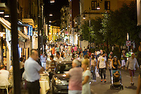 Tourists and locals walk along Corso Italia, the city's main street, on Thursday, Sept. 17, 2015, in Sorrento, Italy. On summer evenings, the street is closed to cars. (Photo by James Brosher)