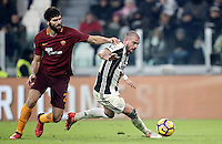Calcio, Serie A: Juventus vs Roma. Torino, Juventus Stadium,17 dicembre 2016. <br /> Juventus' Stefano Sturaro, right, is challenged by Roma's Federico Fazio during the Italian Serie A football match between Juventus and Roma at Turin's Juventus Stadium, 17 December 2016.<br /> UPDATE IMAGES PRESS/Isabella Bonotto