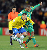 Luis Fabiano of Brazil and Kagisho Dikgacoi of South Africa. Brazil defeated South Africa 1-0 during the semi-finals of the FIFA Confederations Cup at Ellis Park Stadium in Johannesburg, South Africa on June 25, 2009..