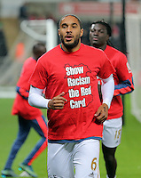 """Ashley Williams of Swansea warms up wearing a """"Show Racism the Red Card"""" shirt before the Barclays Premier League match between Swansea City and Stoke City played at the Liberty Stadium, Swansea on October 19th 2015"""