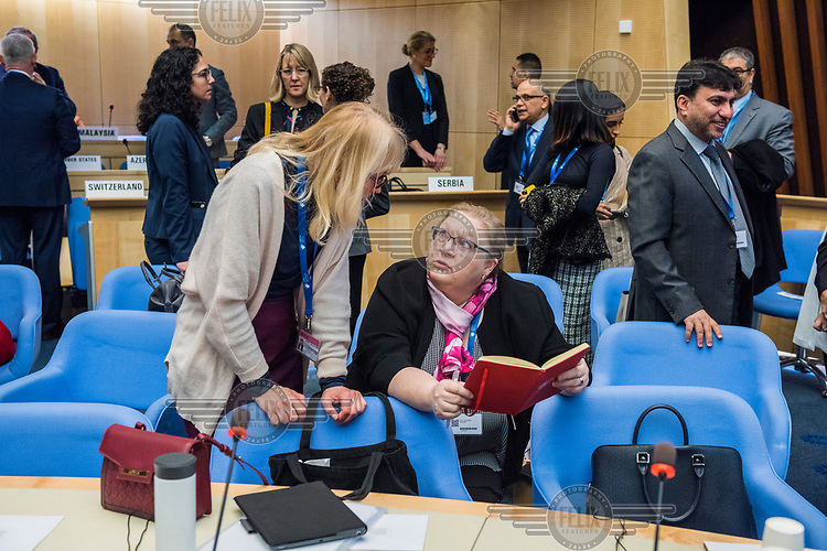 Discussons before the opening session of the Executive Board Meeting of the World Health Organisation, the UN's health body, at the organisation's headquarters in Geneva. The annual event is taking place in the shadow of the Corona virus outbreak, which the WHO has declared as global health emergency.