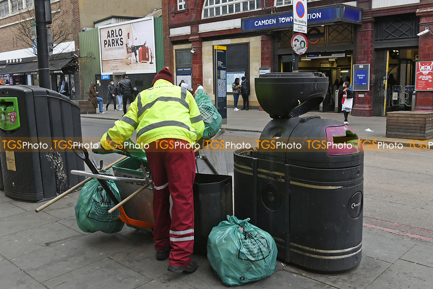 The bins are cleared outside Camden Town underground station as the COVID-19 lockdown restrictions start to ease across the UK on 2nd April 2021