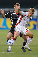New England Revolution forward Taylor Twellman fighting to keep control of the ball against DC United defender Bryan Namoff. DC United defeated the New England Revolution 1-0 at RFK Stadium, Washington DC, June 3, 2006.