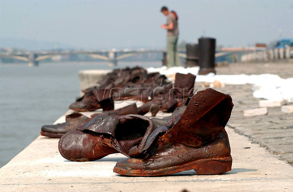 epa000413372 A monument consisting of 60 contemporary shoes made of cast iron in memory of the Jewish people who were shot in to the River Danube by members of the Hungarian nazi party, the so-called Arrow-Cross Party during World War II, is seen at the quay of the River in Budapest, 15 April 2005, on the eve of the Holocaust Memorial Day marking the 60th anniversary of the beginning of the Hungarian holocaust during which some 600 thousand Jewish Hungarians were deported to Nazi death camps. The memorial will be inaugurated Saturday.  EPA/BARNABAS HONECZY HUNGARY OUT