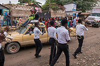 Haiti, Gros-Morne. Mercy Beyond Borders ten year anniversary party. Parade and musicians marching in the street in celebration.
