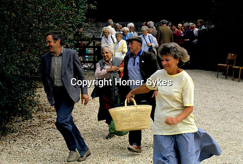 'ENGLISH VILLAGE FETE', THE GATES HAVE BEEN OPENED AND A BAND OF ENTHUSIASTIC WHITE ELEPHANT STALL FANS RUSH TO GET THERE FIRST TO BUY THE BEST THINGS.