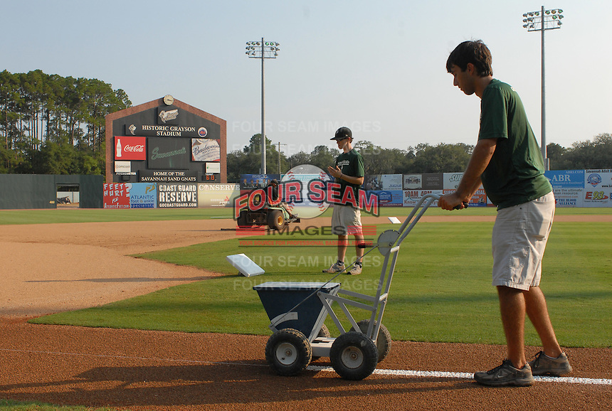 The Savannah grounds crew works on the field prior to a game between the Savannah Sand Gnats and the West Virginia Power on July 21, 2011, at Grayson Stadium in Savannah, Georgia. (Tom Priddy/Four Seam Images)