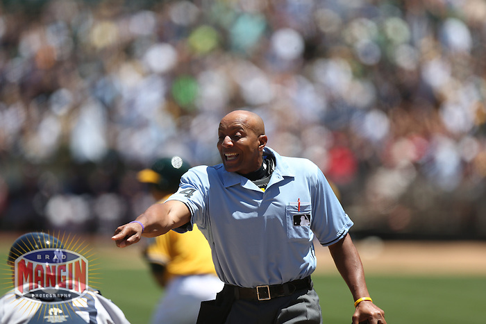 OAKLAND, CA - JUNE 13:  Home plate umpire CB Bucknor makes a call during the game between the New York Yankees and the Oakland Athletics at O.co Coliseum on Thursday June 13, 2013 in Oakland, California. Photo by Brad Mangin
