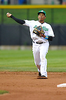 Martin  Peguero #7 of the Clinton LumberKings throws to first base  against the West Michigan Whitecaps at Ashford University Field on July  25, 2014 in Clinton, Iowa. The Whitecaps won 9-0.   (Dennis Hubbard/Four Seam Images)