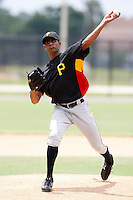 """July 13, 2009:  Pitcher Rinku Singh of the GCL Pirates warms up on a side field before going in to pitch during a game at Tiger Town in Lakeland, FL.  Singh faced one batter, a strike out, to earn the first win for a pitcher from India.  Singh along with Dinesh Patel were signed out of India through the contest """"The Million Dollar Arm"""".  The GCL Pirates are the Gulf Coast Rookie League affiliate of the Pittsburgh Pirates.  Photo By Mike Janes/Four Seam Images"""